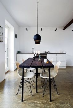 dining /// thin dark wooden table / vintage white eames