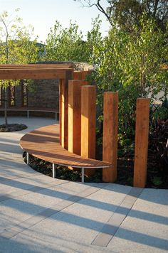 Landscape Design - Curved timber benchseat and curved timber bollards