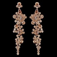 "This exquisite dangling earring set features an assortment of round shimmering peach rhinestones on a rose gold-plated back. These earrings are sure to impress at your next big event!  3"" x 0.75"""
