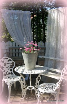 sheer curtains in the garden - outdoor privacy - breezy look, still allows air flow, can be easily opened, lovely backdrop for cottage garden or extended shabby chic decor - doesn't block light either - much less expensive than board fences