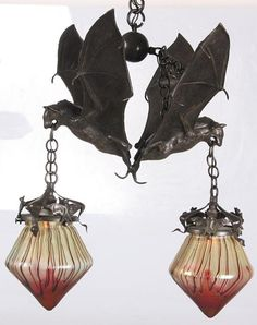 Austrian Double Bat Hanging Lamp. Bronze fixture with 2 opposite facing bats with spread wings.  Loetz attributed shades have a blood motif.  Amazing and creepy.