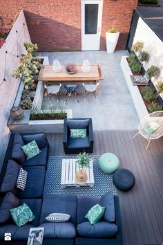 I like the way this garden has two areas with the patio dining area and more casual decked cosy seating space.