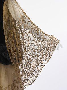 Evening ensemble (sleeve detail) Paul Poiret  Date: 1924 Culture: French Medium: cotton, fur, metallic thread, silk Accession Number: 1978.367.3a, b