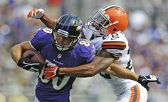 Cleveland Browns cornerback Buster Skrine, right, wraps up Baltimore Ravens tight end Dennis Pitta during the second half of an NFL football game in Baltimore, Md., Sunday, Sept. 15, 2013. (AP Photo/Gail Burton)