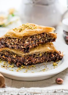 Chocolate Baklava - sweet crisp and buttery layers of phyllo filled with pistachios, walnuts, hazelnuts and Nutella, baked then drizzled with a honey syrup.