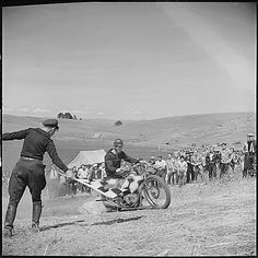 """Santa Clara County, California. Motorcycle and Hill Climb Recreation. At the start of the course. The going gets even rougher and steeper further on. The crowd in the background is composed almost entirely of young fellows. At the bottom of the hill can be seen the parking area. Besides the automobiles, approximately 200 motorcyclists had come to this Sunday event, 04/05/1940."" (US National Archives)"