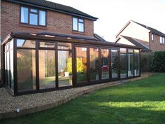 Rosewood PVCu DIY Lean-to Conservatory. Sunlounge Conservatories Manufactured and supplied by ConservatoryLand DIY Conservatories.  Conservatory photos kindly supplied by our customers.