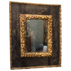 Carved Giltwood and Black Polychrome Spanish Baroque Mirror Frame | From a unique collection of antique and modern wall mirrors at https://www.1stdibs.com/furniture/mirrors/wall-mirrors/