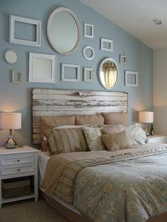 Our master bedroom, I got the idea from a pottery barn catalog for the headboard, we used an old barn door, cost 30 bucks for the door plus the lacker to seal it, and it was about 300 at pottery barn! Then we did a collage of vintage mirrors and vintage along with some newer picture frames and just painted them all shades of white!