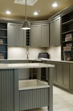 Great colors and storage in this craft room - the cabinets are nicer than some kitchens!