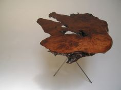 Used to have a table like this.  Well, actually it was a cypress top on a cypress stump, bought on a Florida roadside.  Really brought the natural world inside, in a good way!!!
