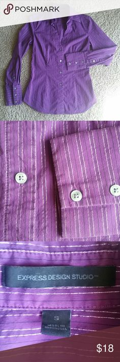 Express sparkle dress shirt This is a beautiful dress shirt! Pin striped with black and silver sparkle, a purple color. No holes tears or snags. Amazing fit to give you a nice Waist. Perfect with pants or a pencil skirt. Express Tops Button Down Shirts