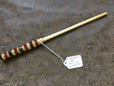 A personal favorite from my Etsy shop https://www.etsy.com/listing/492881237/multiwood-harry-potter-inspired-wand