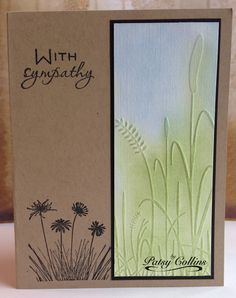 """By Patsy Collins. Dry emboss white cardstock panel in Darice """"Grass"""" folder. Sponge to color. Cut to size; mat on black; add to kraft card base. Stamp sentiment and flowers in black at left. Copy of card by Elke Verschooten."""