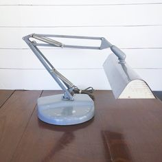 A wonderful, gray mid century articulated architect lamp by Luxo. This is a rare flourescent, FL-2, desk light. What an amazing industrial look this Luxo lamp has; just imagine it in your home! A wonderful addition to a modern or industrial home or office! Industrial House, Modern Industrial, Electric Window Candles, Architect Lamp, Desk Lamp, Table Lamp, Anglepoise Lamp, Indian Doors, Beaded Curtains