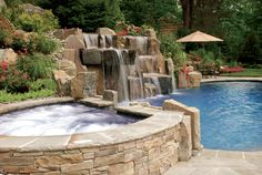 gorgeous in ground zero edge swimming pool spa and waterfalls installation including stone patio saddle river new jersey