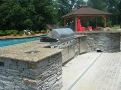 Outdoor Kitchen with Granite Countertops in Charlotte NC | http://www.fireplacecarolina.com