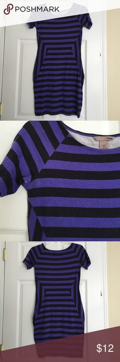 H&M purple and black striped short sleeve dress Comfy and casual! Small stain on the right underarm (2nd pic). 52% viscose, 44% cotton, 4% elastane. 35 inches long. H&M Dresses