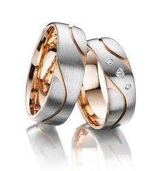 14 K Rose gold and white gold with Diamond on women wedding band. 5MM width for women, 6mm width for men. Sell in pairs also sell in single.