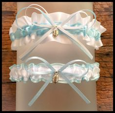 "Very Sexy White & Light Blue garter Set embellished with a coordinating bow featured with a Football Charm for added elegance.    ** Garter measures: 1.5"" W **  ** Toss Garter Measures: 7/8"" W **    * Garter listing is for standard size, if interested in custom size please contact prior to purchasing. * 