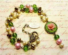 Lovely rose necklace in green and pink by TillaDesigns on Etsy, $25.95