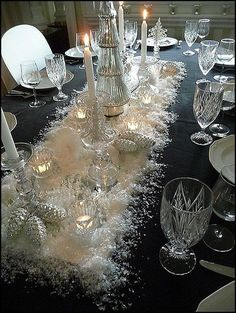 Elegant Winter or Christmas table ~ Long Mirror, Faux Snow, Crystal Candle Holders, dark blue tablecloth, Silver Pine Cones. Christmas Dining Table, Christmas Table Settings, Christmas Tablescapes, Christmas Table Decorations, Holiday Tablescape, Winter Wonderland Decorations, Winter Decorations, Christmas Candles, Thanksgiving Table