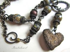 Open your Heart.Talisman gothic boho long necklace. $58.00, via Etsy.