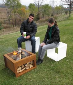 "TRAE's convenient wood shelter keeps extra logs handy so you can stay close to the fire. And those logs are sure to be dry, nestled under the pit. Made of 1/8"" steel with a natural rust finish and ste"
