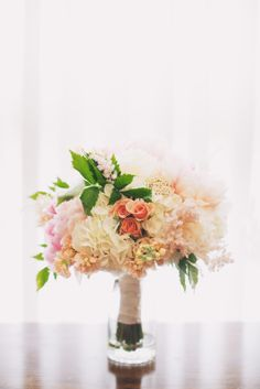 "For the bride, peach ""ilse"" spray roses, faded coral charm peonies, peach astilbe, ivory hydrangea, rice flower and stock all combined with accents of gardeny-green foliages ~ YUM!!"