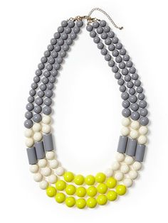 We hate saying goodbye to scarves when the weather warms up. Our solution? A bright statement necklace!!