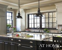 love the black cabinets and window frame