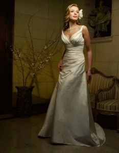 This simple and classy dress is at Bobbies Bridal in Peoria, IL! casablanca1831