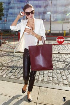 Miranda Kerr in brown leather trousers, white blazer and Celine tote bag