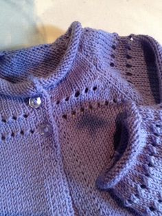 Seriously, could this BE any simpler?  Rolled stockinette neckline and cuffs and yarn overs to increase....CARDIGAN SIZE PERIWINKLE 2-4-6-8-10 YEARS