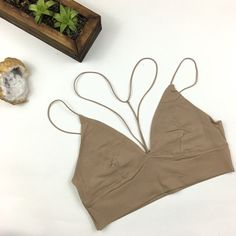 RESTOCKED! Taupe Y-Neck Bralette Super soft taupe bralette with ultra thin straps and y-neck detail. 95% Nylon 5% Spandex. Looks great layered under a top or dress, but can also work as a crop top. Brand new. Recommended Cup Fit S: 32C, 32D,34A,34B M: 34C, 34D, 36A, 36B L: 36C, 36D,38A,38B Please carefully review each photo before purchase as they are the best descriptors of the item. My price is firm. No trades. First come, first served. Thank you! :) Intimates & Sleepwear Bras