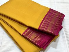 Mindblowing handwoven pure korvai kanchipuram silk in a stunning yellow with rani pink combination with beautifully woven borders rich pallu and contrast woven blouse cost