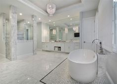 This master bathroom with a freestanding tub, walk-in shower, and dual sink vanity paired with a large frameless mirror. These are all topped with a brilliant tray ceiling. House Bathroom, Modern Master Bathroom, Luxury Modern Homes, Master Bathroom Design, Luxury Homes Interior, Luxury Homes, Luxury Master Bathrooms, Luxury House Designs, Modern House Plans