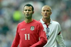 Ryan Giggs of Wales shadowed by David Beckham