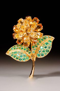 René Boivin rare gold, citrine and emerald flower brooch, circa 1950 - 1959.