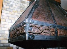 An example of forged iron use on a kitchen range hood. #forgediron #mycustommade #rangehood