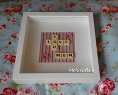 LOVE YOU MUM In scrabble letters framed in a Box Frame with a striped background. Scrabble Tile Crafts, Scrabble Art, Scrabble Letters, 3d Box Frames, Box Frame Art, Mothers Day Scrabble, Button Family Picture, Letter Pictures, Button Art On Canvas