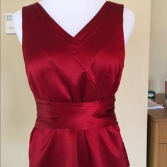 "Red deep V sleeveless blouse Beautiful red V Neckline with pleats on the back.  Blouse has wide sash tie side zip. Never worn. NWT. Length from top of sleeve is 22"". Fully lined 100% Silk. Lining 100% polyester.  Dry Clean only. Size 6p Ann Taylor Tops Blouses"