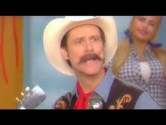"""In a new video released today by FunnyorDie.com, comedian Jim Carrey appears as Charlton Heston in a parody of the country music/comedy show 'Hee Haw.'    As Heston, Carrey talks about UFOs and then introduces the country act 'Lonesome Earl And The Clutterbusters.'*    Jim Carrey made a song parody for Funny or Die making fun of gun nuts, which obv..."