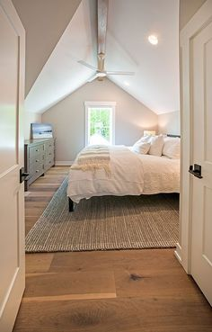 Guest Bedroom of Tall Cedar House Plan. This modern farmhouse floor plan is 1930 sq ft and has 3 bedrooms Guest Bedroom of Tall Cedar House Plan. This modern farmhouse floor plan is 1930 sq ft and has 3 bedrooms, bathrooms, floors, and a 2 car garage. Attic Master Bedroom, Attic Bedroom Designs, Attic Bedrooms, Upstairs Bedroom, Bedroom Loft, Guest Bedrooms, Home Bedroom, Bedroom Storage, Attic Bedroom Decor