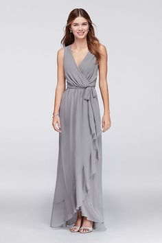 Sleek, simple, and ready to accessorize, this faux-wrap chiffon bridesmaid dress is a perfect pick for modern-minded \'maids who want to put their own stamp on their big-day look.   By Violets and Ros