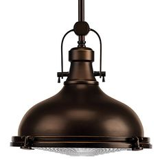 Vintage and modern in styling, this pendant is born from industrial roots in both form and function. An authentic fresnel type glass lens refracts light from the metal shade. The lens is supported by a series of decorative and functional metal fittings for easy access to change the light bulb when needed. Stem-type hanging system provides several options for installation height and includes 6 in. of chain for installation on sloped ceilings.