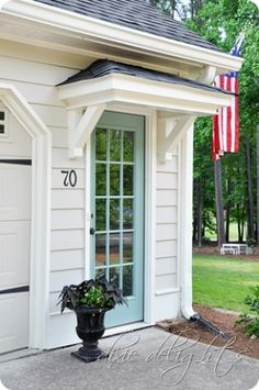 Portico over side entry garage door . maybe create similar outside door entry in to our garage, but on side of house - love the covered portico detail over entry (but would have different door) New Homes, Exterior Design, House, Curb Appeal, Home, Back Doors, Door Overhang, Doors, House Exterior