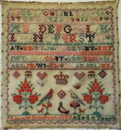 Late 19th century sampler by Lizzie Simpson aged 11 - 1899. The upper section of the gauze is stitched with rows of alphabet letters, numbers and border patterns finishing with three rows of family initials. | eBay!