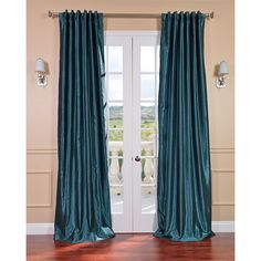 Decorate your windows with color and texture with this bold faux silk curtain panel. The deep green color of this panel accents most rooms nicely, and adds a hint of depth to your decor. This panel is heavy, and includes a rod pocket for hanging it up.