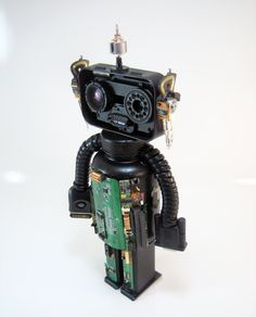 Found object robot. Junk art object assemblage. Recycled
